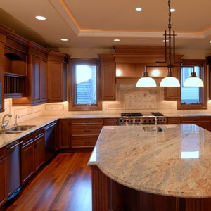 Modern kitchen with granite counters and pendant lights